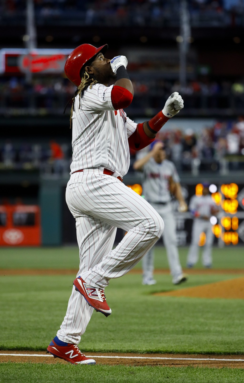 Philadelphia Phillies' Maikel Franco reacts as he rounds the bases after hitting a three-run home run off New York Mets starting pitcher Steven Matz,