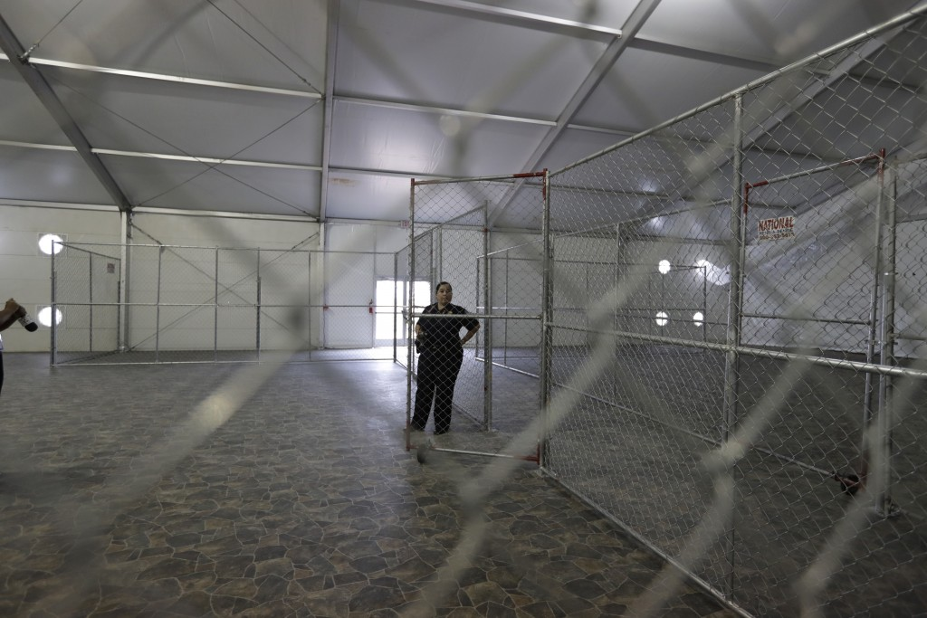 FILE--In this Dec. 7, 2016 file photo, a U.S. Customs and Border Protection agent stands in a temporary holding facility near the Donna-Rio Bravo Inte
