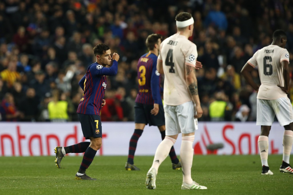 Barcelona forward Philippe Coutinho, left, celebrates after scoring his side's third goal during the Champions League quarterfinal, second leg, soccer