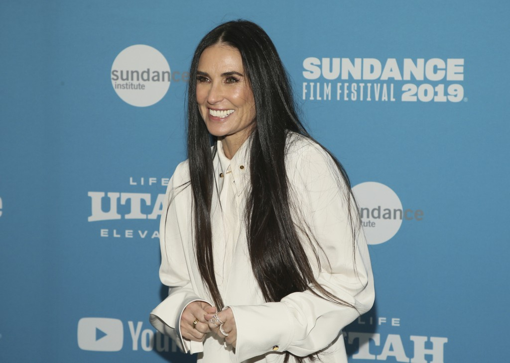 "FILE - In this Tuesday, Jan. 29, 2019 file photo, actress Demi Moore poses at the premiere of the film ""Corporate Animals"" during the 2019 Sundance Fi"