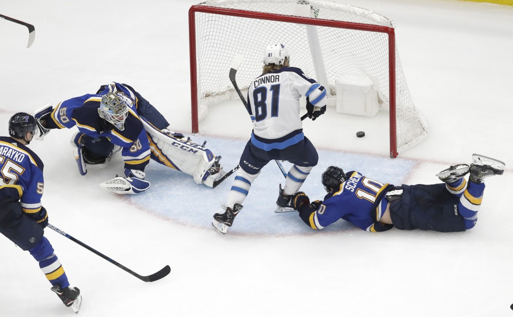 Winnipeg Jets left wing Kyle Connor (81) scores the winning goal between St. Louis Blues goaltender Jordan Binnington (50) and Blues' Brayden Schenn (