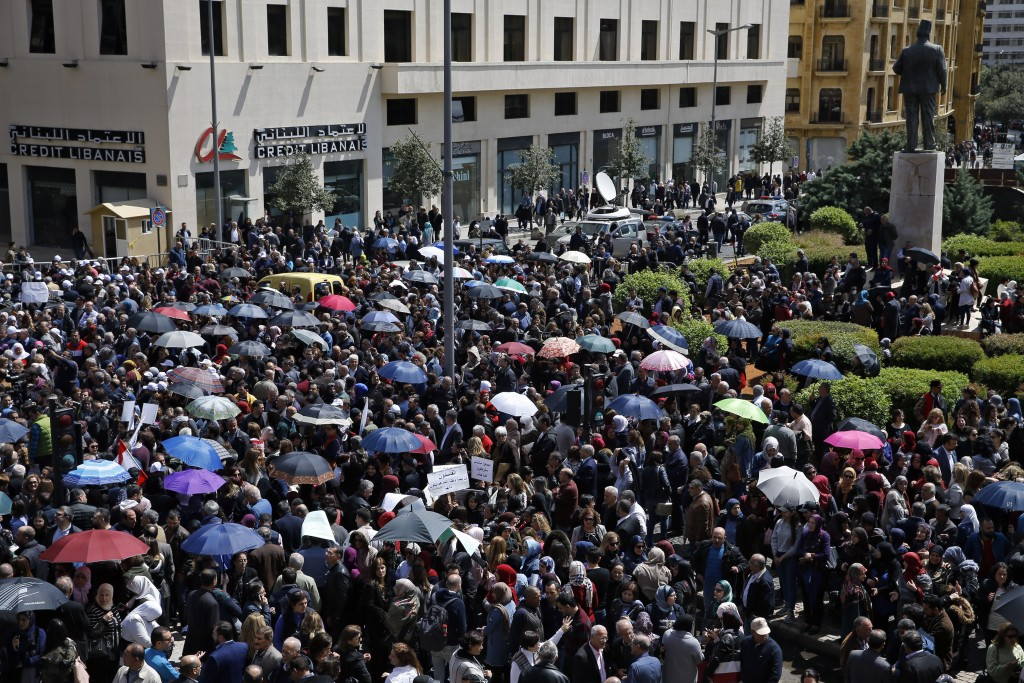 Civil servants protest near the government building during a parliament session to approve a plan to restructure the country's electricity sector, in