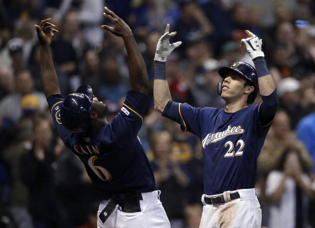 Milwaukee Brewers' Christian Yelich (22) celebrates with Lorenzo Cain (6) after hitting a three-run home run during the fifth inning of the team's bas