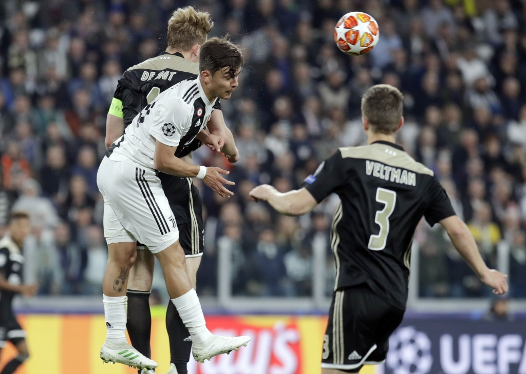 From left, Ajax's Matthijs de Ligt, Juventus' Paulo Dybala and Ajax's Joel Veltman go foe the ball during the Champions League, quarterfinal, second l