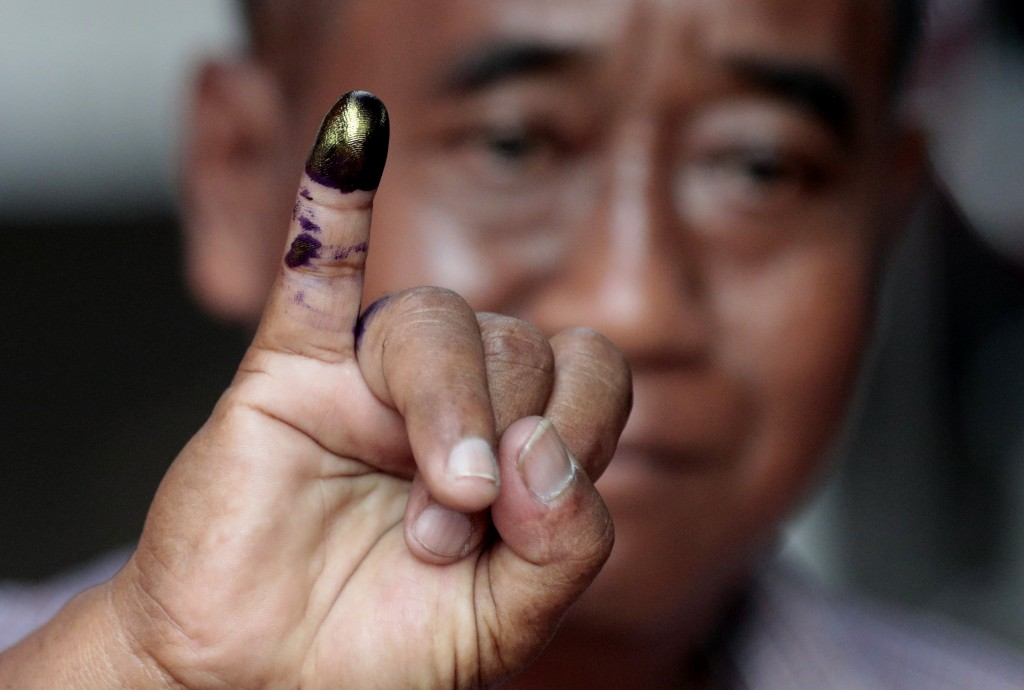 A man shows his inked finger after voting during the election at a polling station in Jakarta, Indonesia, Wednesday, April 17, 2019. Voting is underwa