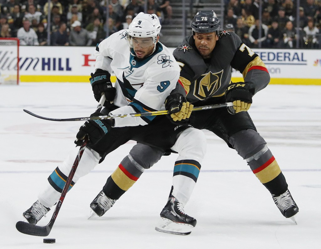 San Jose Sharks left wing Evander Kane (9) tries to skate around Vegas Golden Knights right wing Ryan Reaves (75) during the second period of Game 4 o