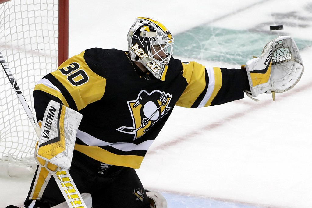 Pittsburgh Penguins goaltender Matt Murray reaches for a shot during the first period in Game 4 of the team's NHL first-round hockey playoff series ag