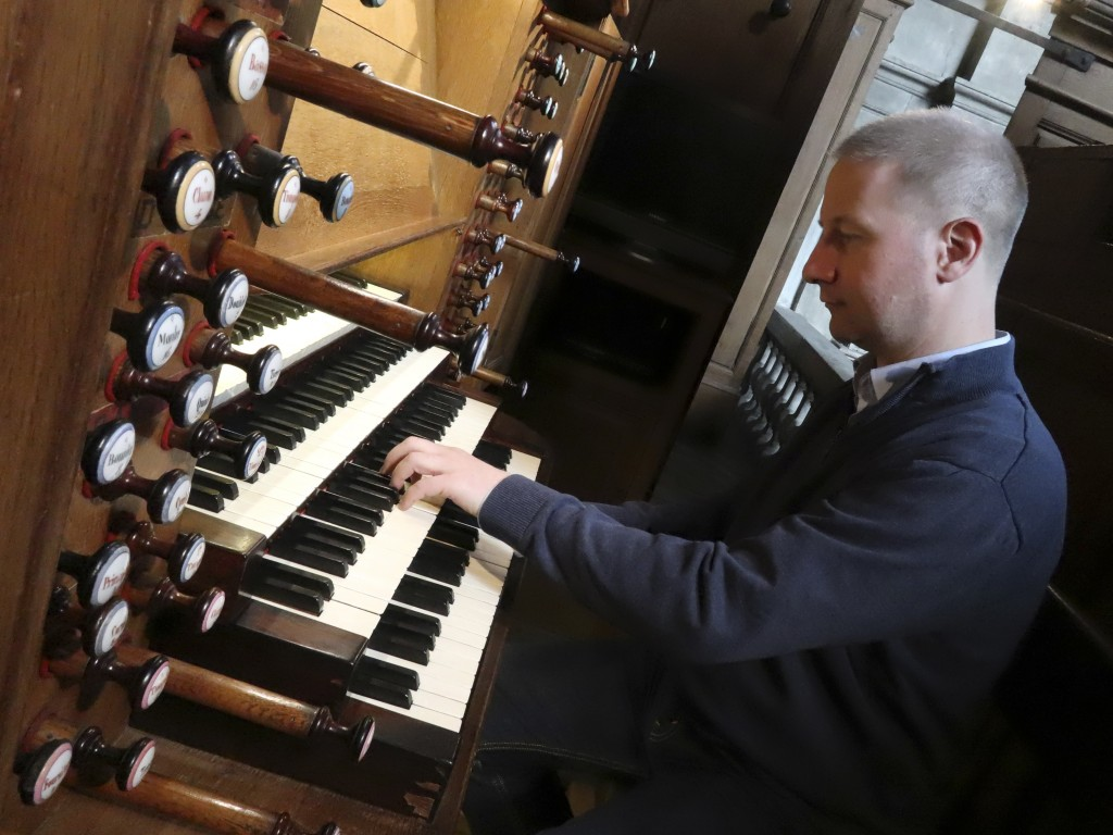 Johann Vexo, the organist who was playing at evening mass inside Notre Dame when flames began licking at the iconic cathedral's roof, pllays the pipe ...
