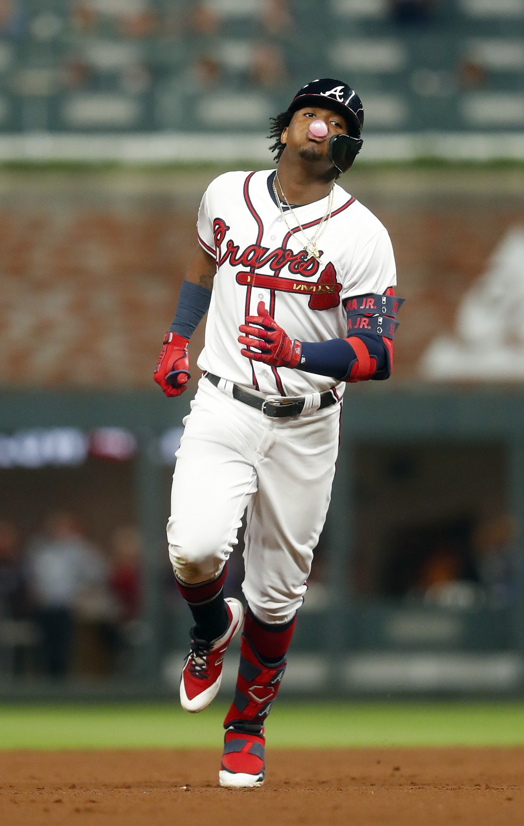 Atlanta Braves' Ronald Acuna Jr. (13) blows a bubble as he rounds the bases after hitting a solo home run in the fourth inning of a baseball game agai...