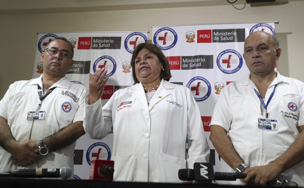Health Minister Zulema Tomas, center, speaks at a news conference at the Casimiro Ulloa hospital where former Peruvian President Alan Garcia was taken