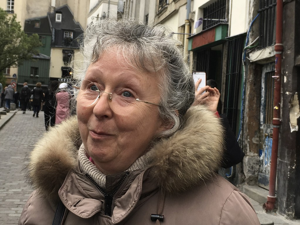 Cecile Deleville smiles during an interview with the Associated Press in Paris Tuesday April 16, 2019. For the 66-year-old Deleville, there is no repl