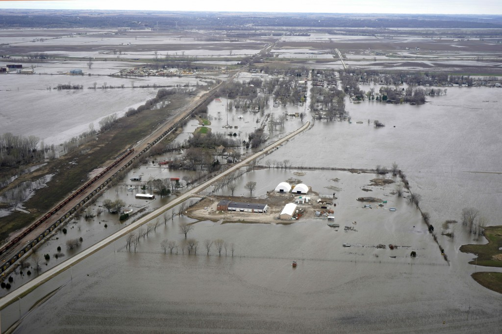In this Friday, April 12, 2019 photo, the flooded town of Pacific Junction, Iowa, is seen from above. This spring's massive flooding along the Missour