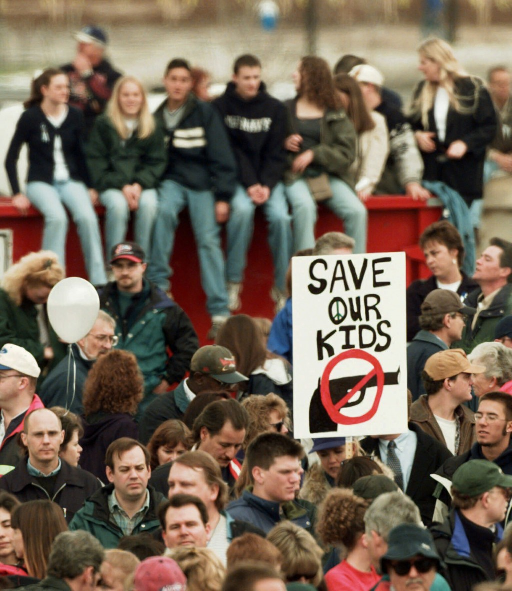 """FILE - In this April 25, 1999, file photo, a participant at a memorial service for the victims of the Columbine High School shooting rampage holds a """""""