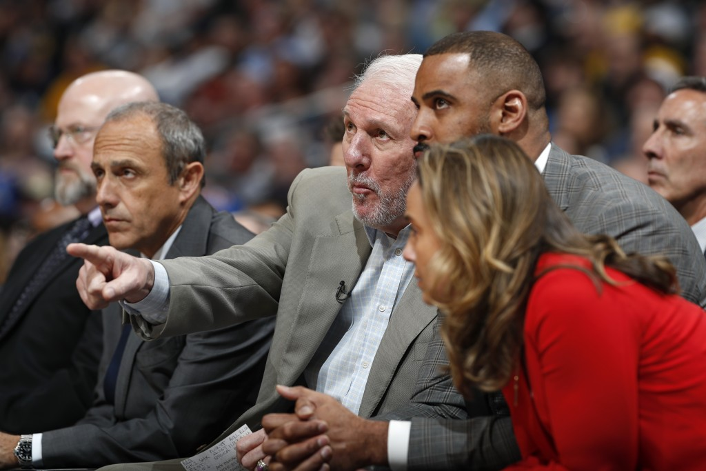 San Antonio Spurs head coach Gregg Popovich directs his team against the Denver Nuggets in the first half of Game 2 of an NBA basketball playoff serie...