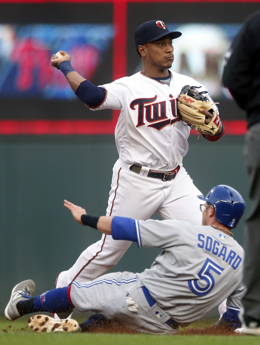 Toronto Blue Jays' Eric Sogard, bottom, is forced out at second as Minnesota Twins shortstop Jorge Polanco completes the double play hit into by Fredd...