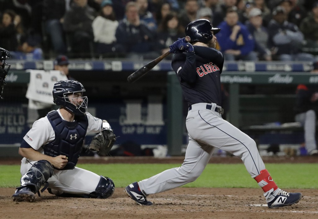 Cleveland Indians' Mike Freeman follows through on an RBI single during the seventh inning of the team's baseball game against the Seattle Mariners, T