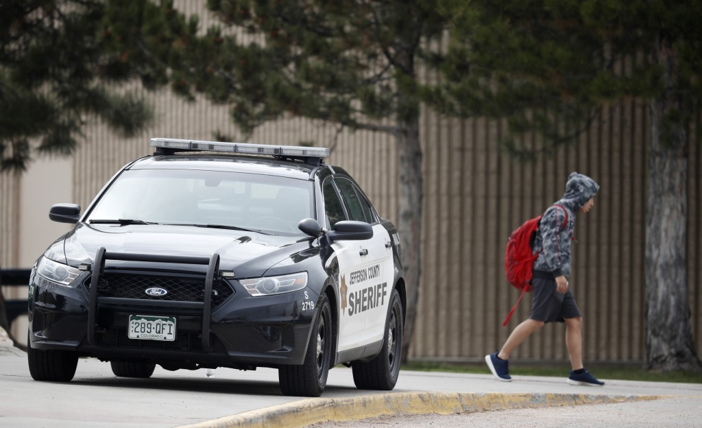 A student leaves Columbine High School late Tuesday, April 16, 2019, in Littleton, Colo. Following a lockdown at Columbine High School and other Denve