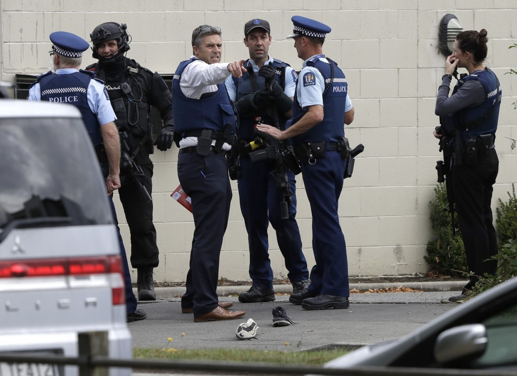 FILE - In this March 15, 2019, file photo, police stand outside a mosque in central Christchurch, New Zealand. New Zealand police on Wednesday, April ...