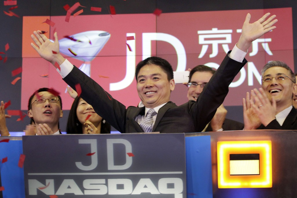FILE - In this file photo taken May 22, 2014, Liu Qiangdong, also known as Richard Liu, CEO of JD.com, raises his arms to celebrate the IPO for his co