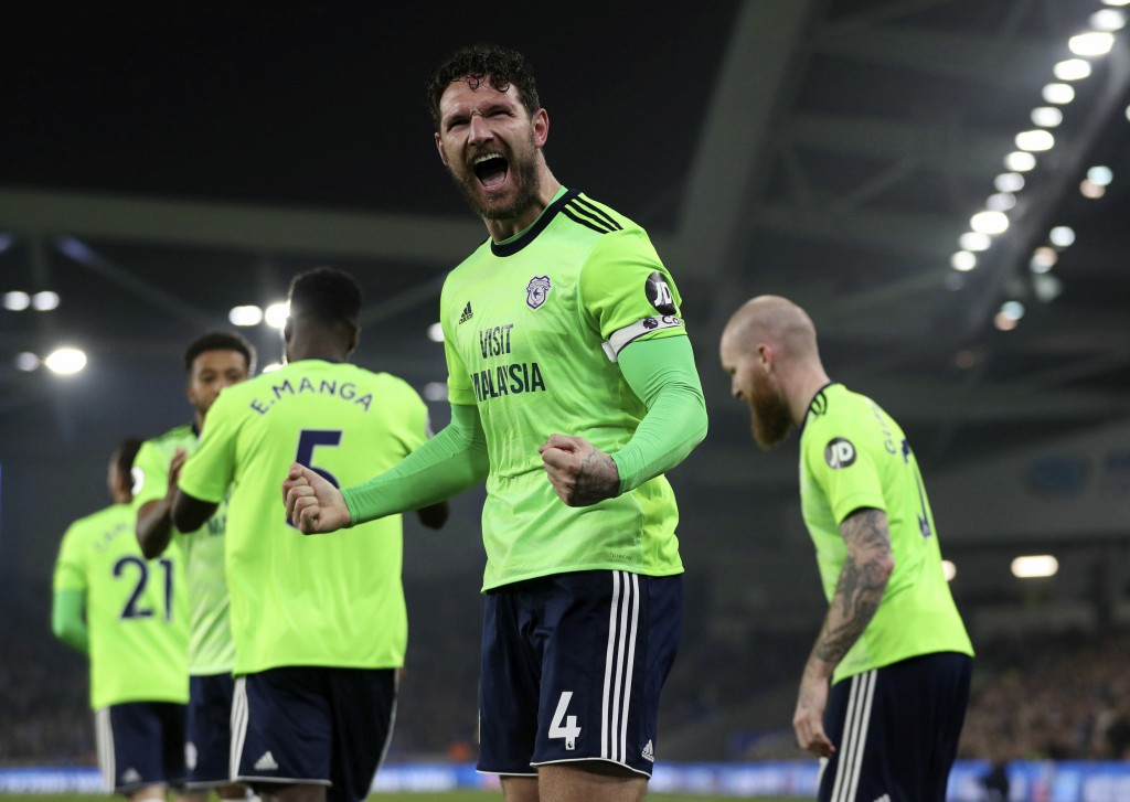 Cardiff City's Sean Morrison celebrates scoring against Brighton during the English Premier League soccer match at the AMEX Stadium, Brighton, England