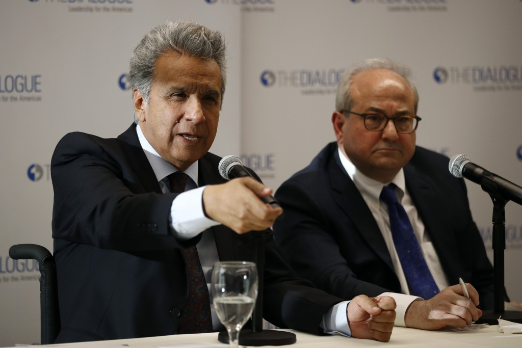 Ecuador's President Lenin Moreno, left, speaks at an event at the Inter-American Dialogue think tank, Tuesday, April 16, 2019, in Washington. (AP Phot