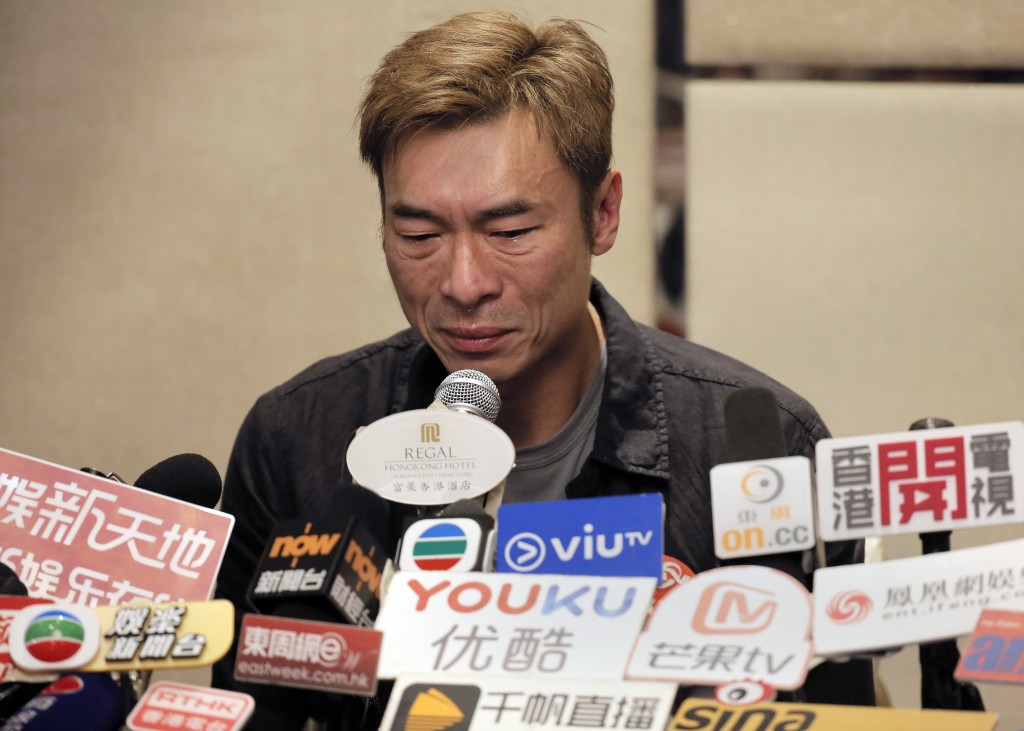 Hong Kong singer Andy Hui reacts during a press conference about his affair in Hong Kong, Tuesday, April 16, 2019. Hong Kong's Apple Daily newspaper p