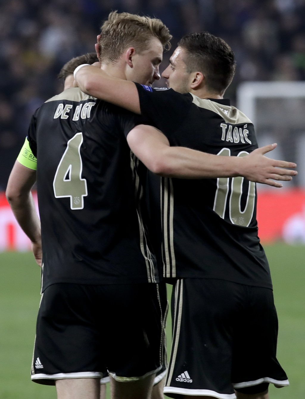 Ajax's Matthijs de Ligt, left, celebrates with his teammate Dusan Tadic after scoring his side's second goal during the Champions League, quarterfinal