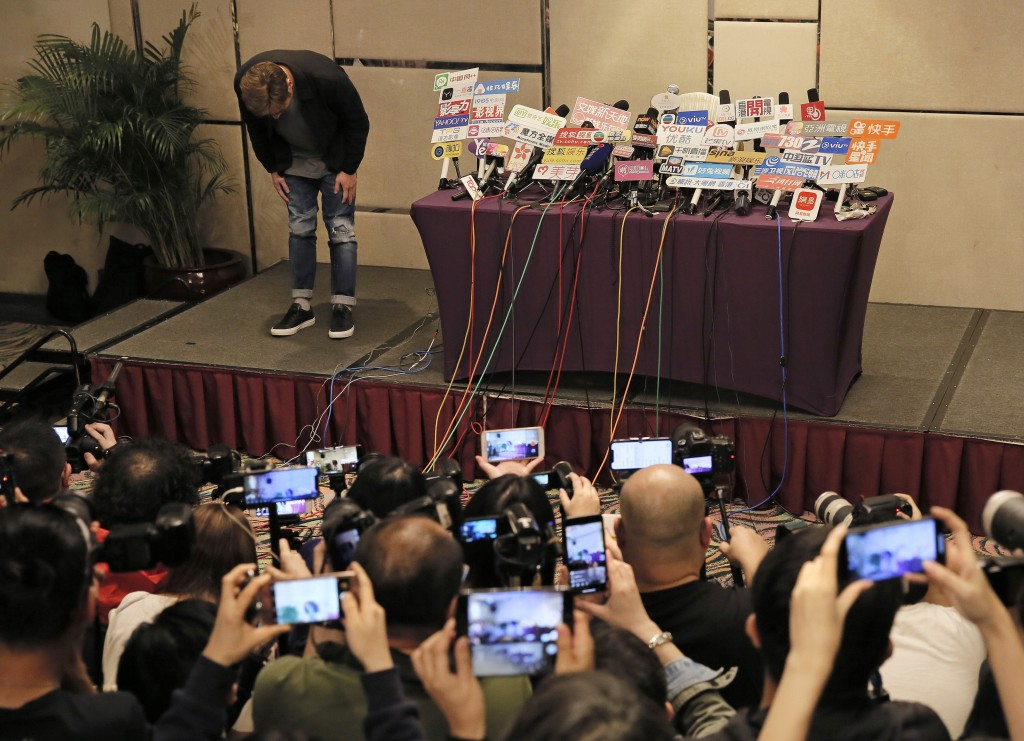 In this Tuesday, April 16, 2019, file photo, Hong Kong singer Andy Hui bows before a press conference about his affair in Hong Kong. Hong Kong's Apple