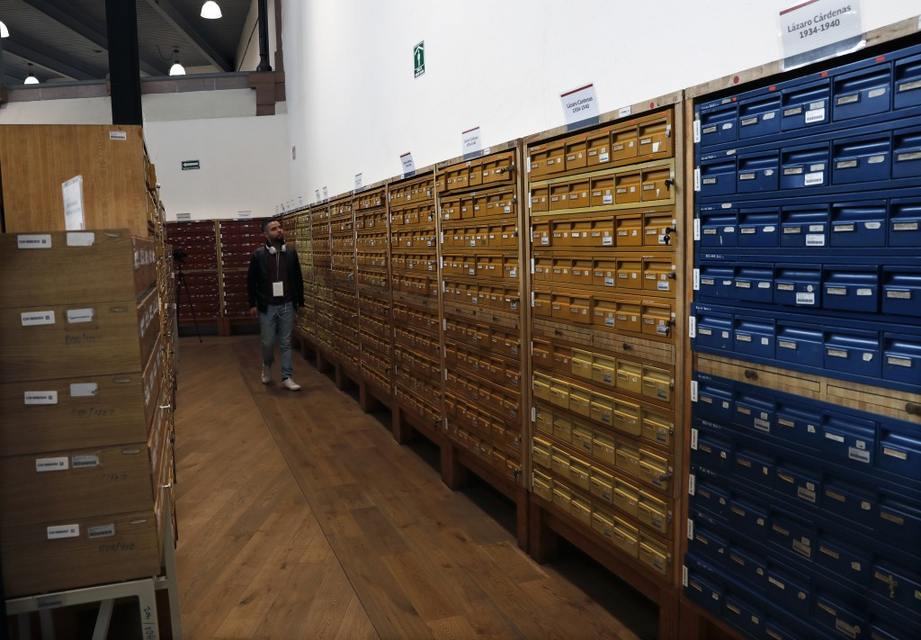 A journalists walks past stored files at the National Archive where old intelligence documents drawn up by spies in 1979 and 1980 from the now-extinct