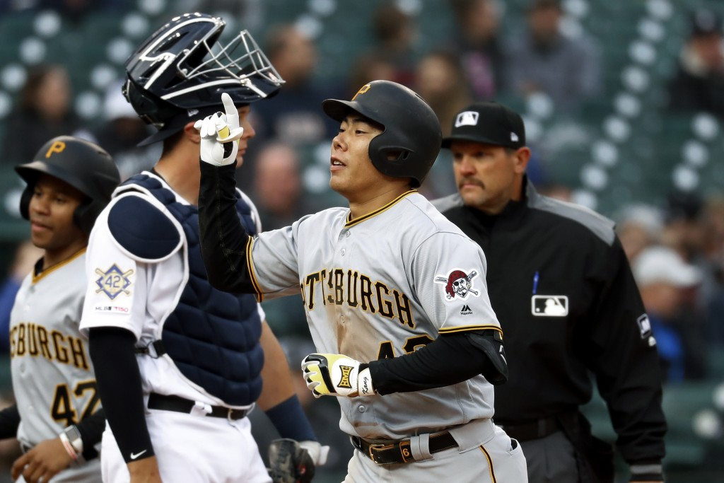 Pittsburgh Pirates' Jung Ho Kang celebrates his two-run home run in the fourth inning of a baseball game against the Detroit Tigers in Detroit, Tuesda