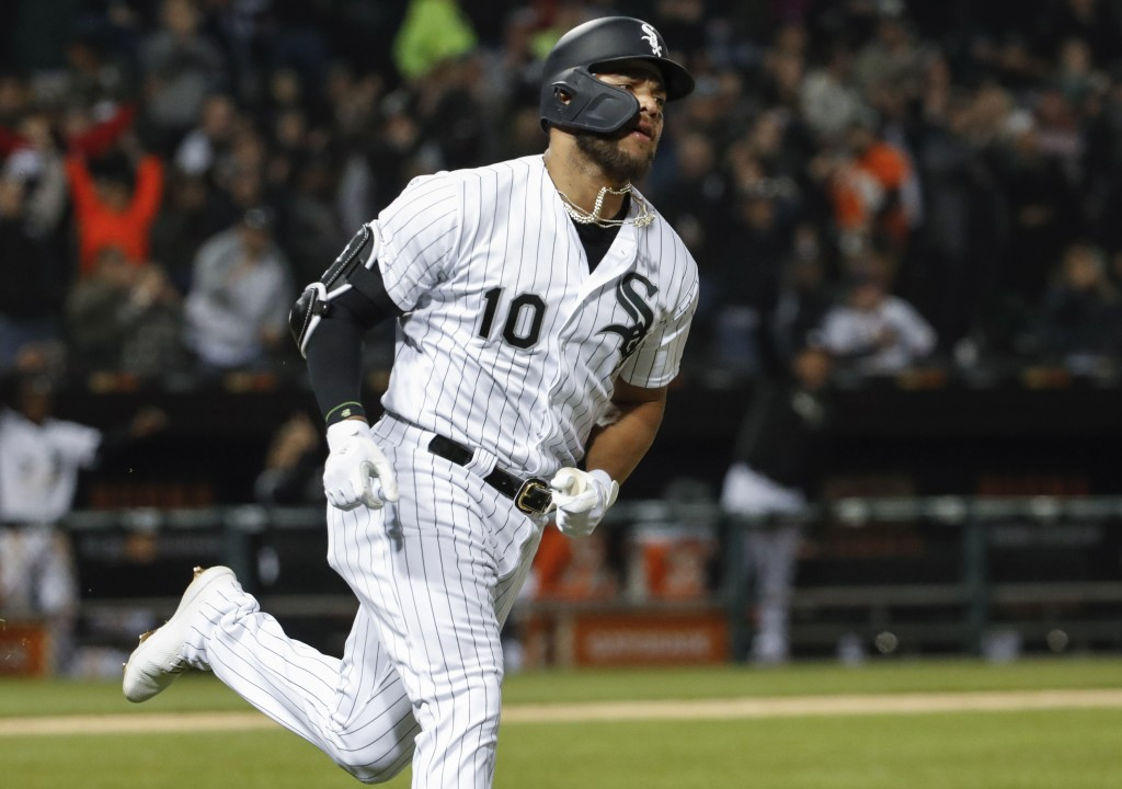 Chicago White Sox's Yoan Moncada rounds the bases after hitting a solo home run off of Kansas City Royals starting pitcher Jorge Lopez during the fift