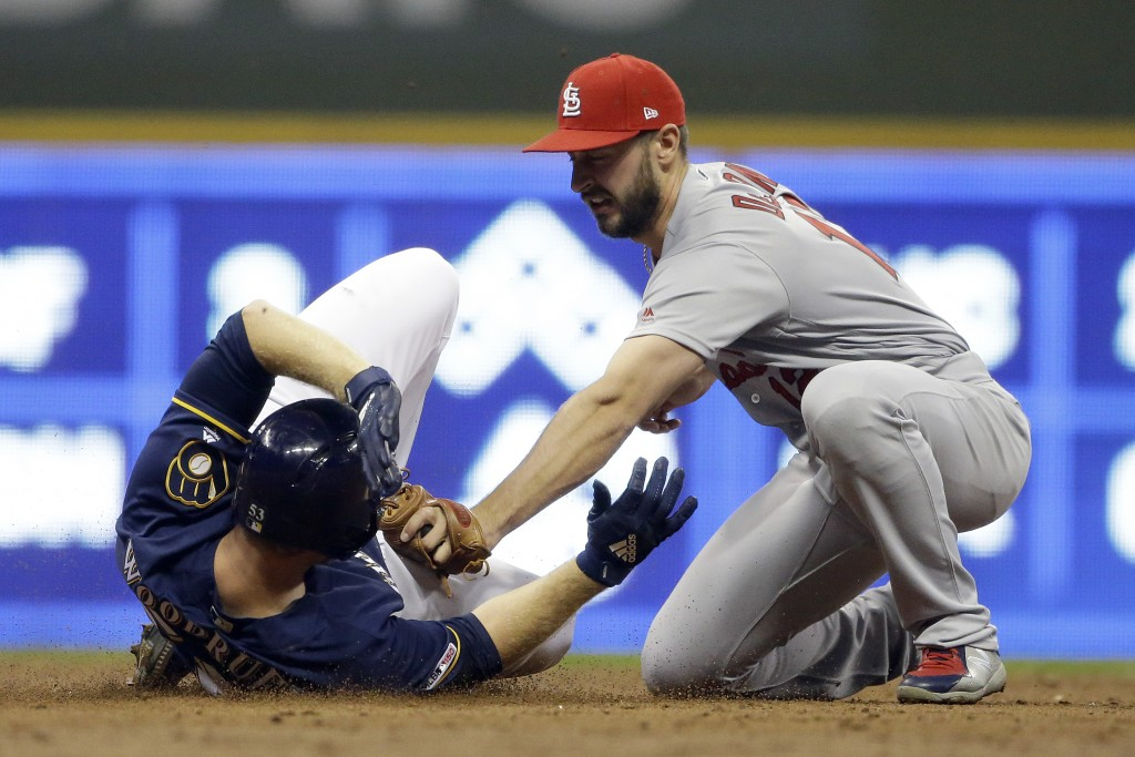 Milwaukee Brewers' Brandon Woodruff slides into second base safely past the tag of St. Louis Cardinals' Paul DeJong after hitting a two-run double dur