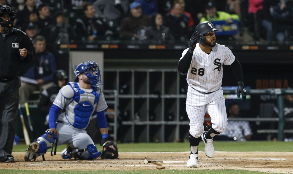 Chicago White Sox's Leury Garcia, right, watches his ball after hitting a two-run home run off of Kansas City Royals starting pitcher Jorge Lopez duri
