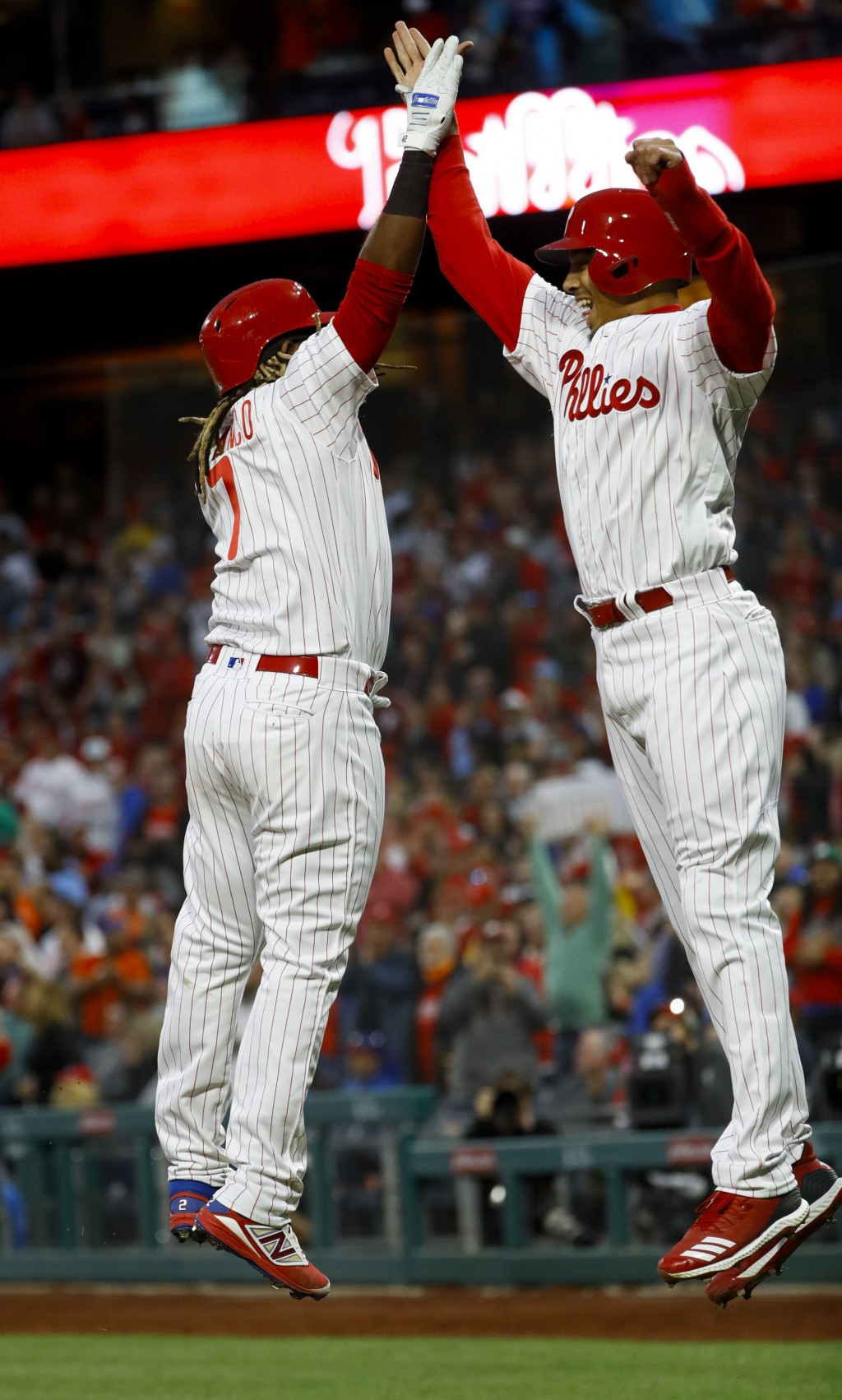 Philadelphia Phillies' Maikel Franco, left, and Aaron Altherr celebrate after Franco's three-run home run off New York Mets starting pitcher Steven Ma