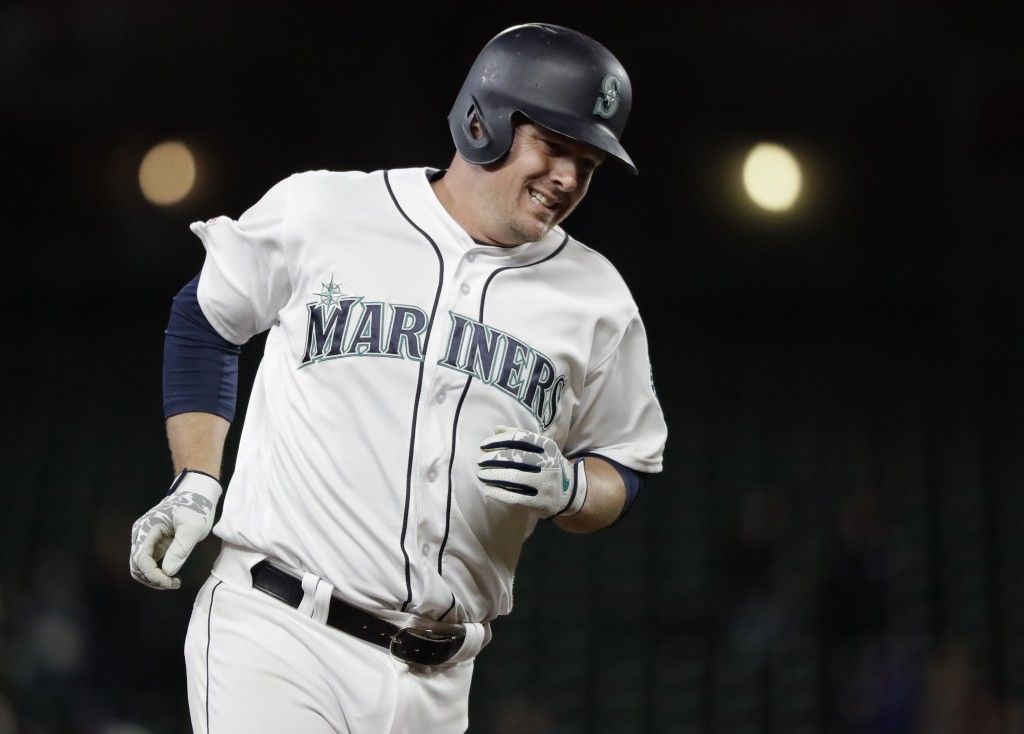 Seattle Mariners' Jay Bruce rounds the bases after hitting a solo home run during the eighth inning of the team's baseball game against the Cleveland