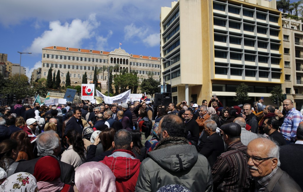 Civil servants protest in front of the government building during a parliament session to approve a plan to restructure the country's electricity sect