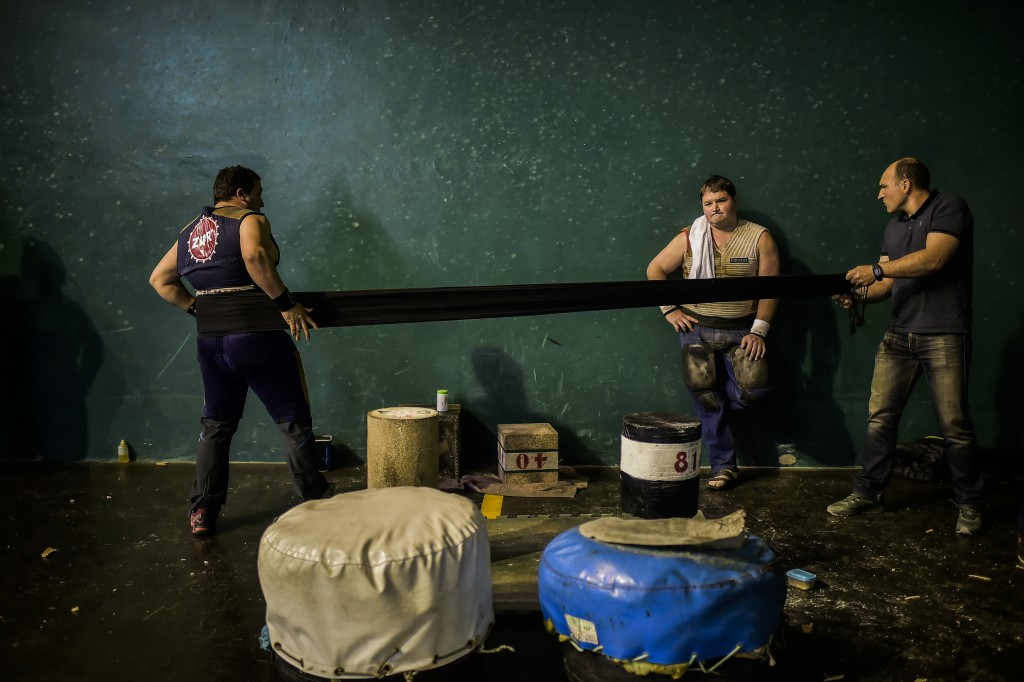 """In this Saturday, April 6, 2019 photo, basque stone lifters prepare for an exhibition in the basque village of Azkoitia, northern Spain. The """"Harri-ja..."""