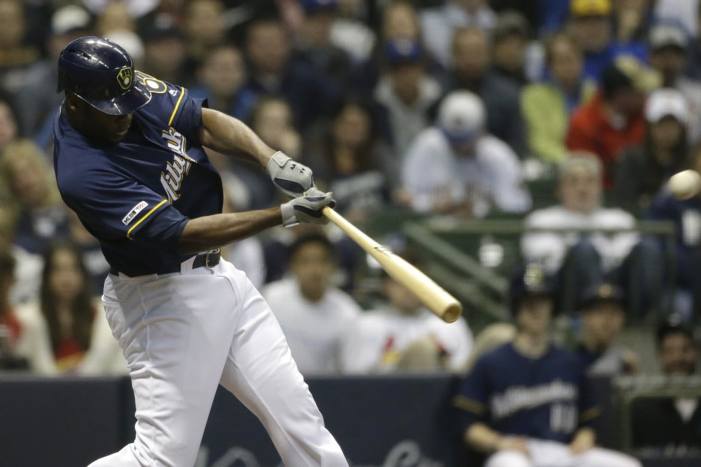 Milwaukee Brewers' Lorenzo Cain hits a solo home run during the third inning of the team's baseball game against the St. Louis Cardinals onTuesday, Ap