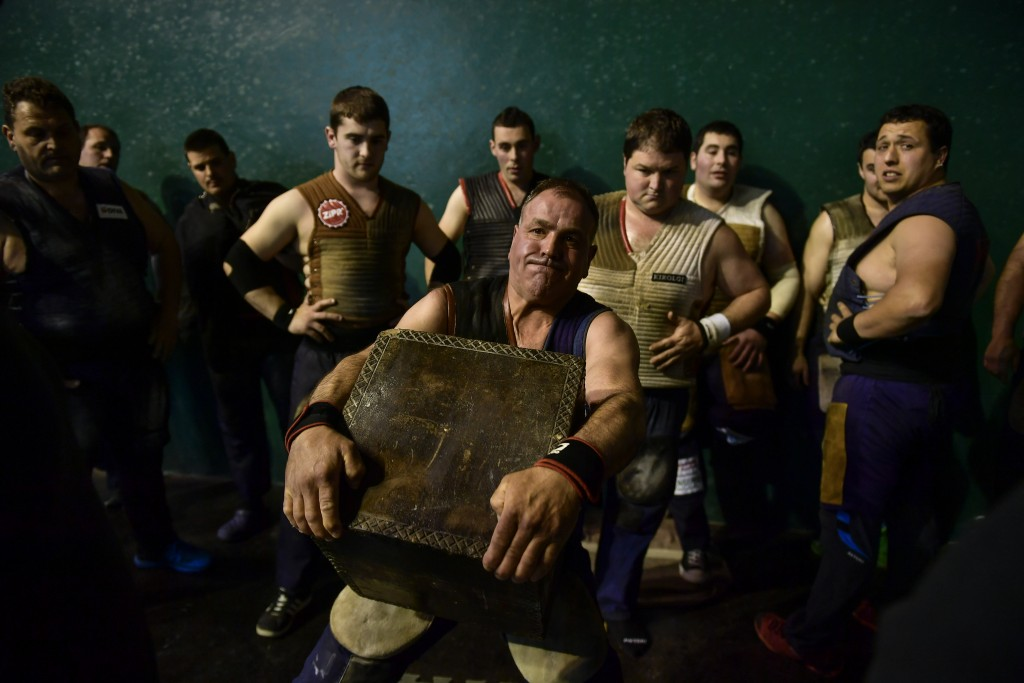 In this Saturday, April 6, 2019 photo, Jose Ramon Izeta, 52, a former basque stone lifter, holds a 100 kilograms stone, during an exhibition in the ba...