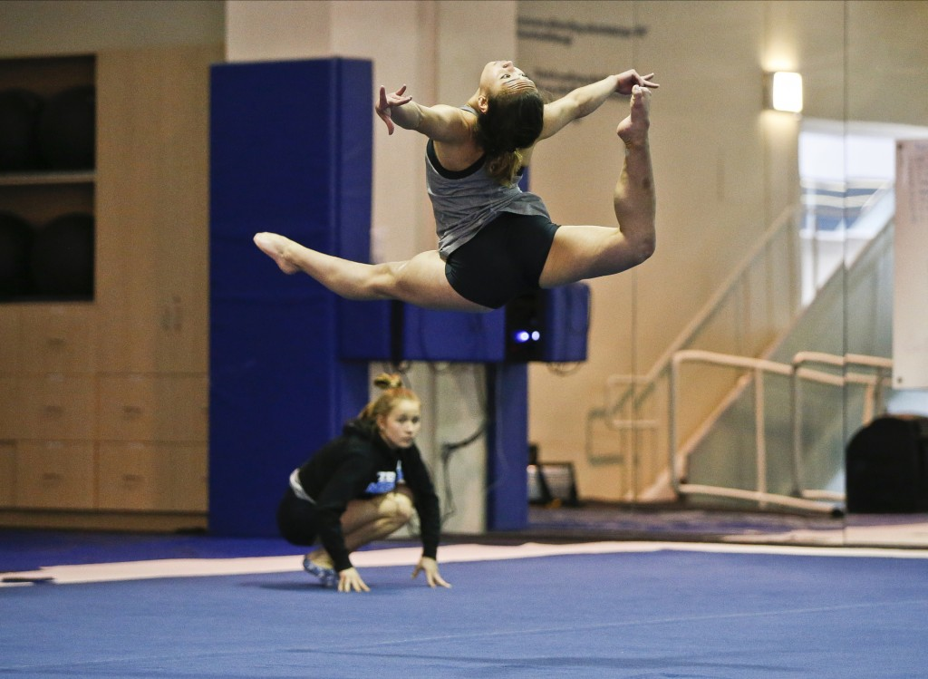 In this Thursday, April 11, 2019, photo, UCLA gymnast Katelyn Ohashi trains on the floor with the University of California Bruins gymnastics team in L