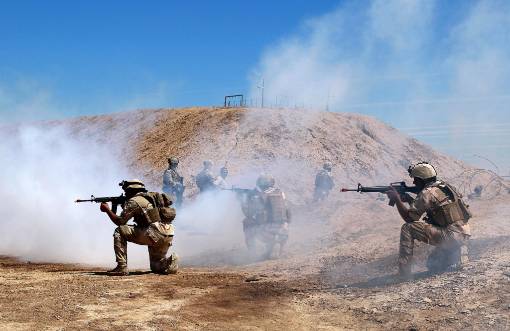 Australian and New Zealand coalition forces participate in a training mission with Iraqi army soldiers at Taji Base, north of Baghdad, Iraq, Wednesday
