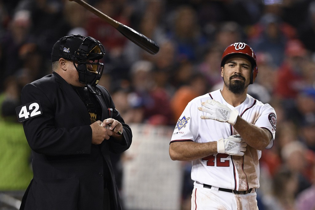 Washington Nationals' Anthony Rendon tosses his bat after he struck out during the fifth inning of the team's baseball game against the San Francisco