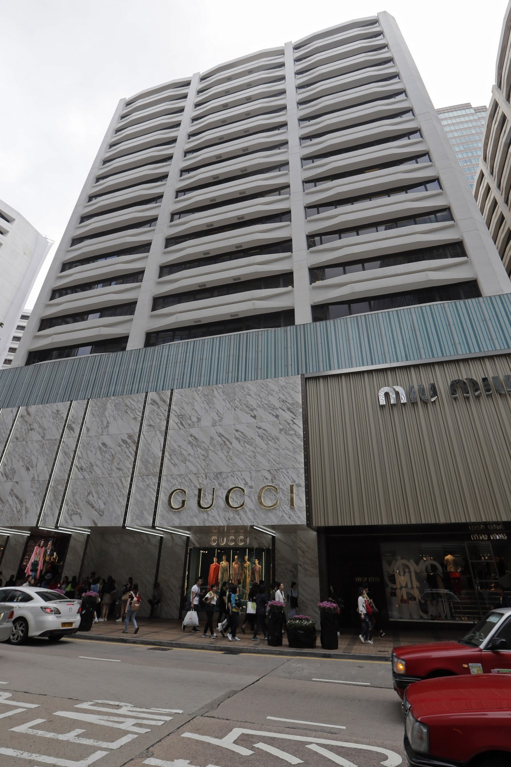This Thursday, March 21, 2019 photo shows the exterior of the Wharf T&T Centre building in Hong Kong. The building was allegedly the home of NPH Inves