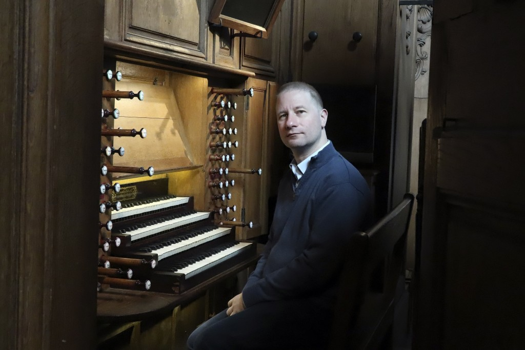 Johann Vexo, the organist who was playing at evening mass inside Notre Dame when flames began licking at the iconic cathedral's roof, poses at the pip