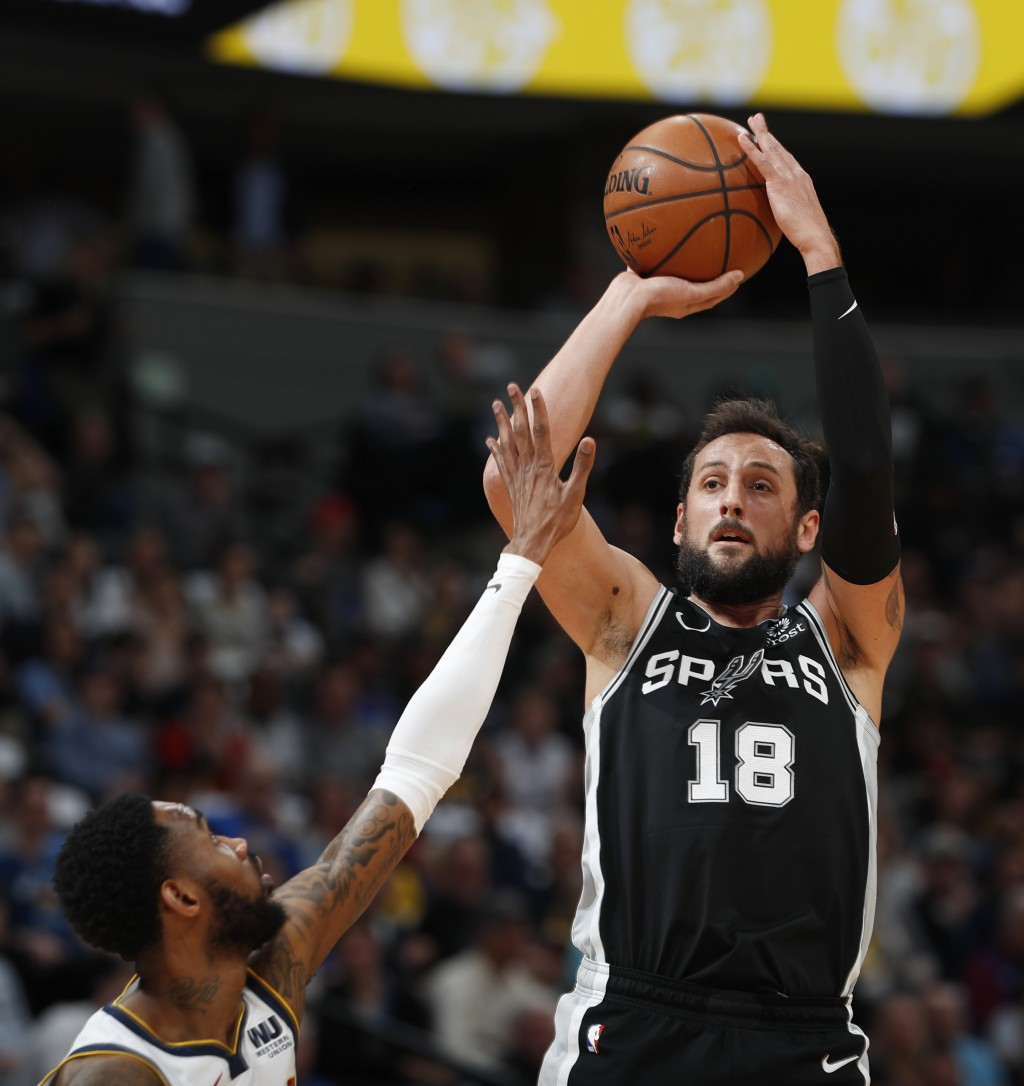 San Antonio Spurs guard Marco Belinelli, right, shoots over Denver Nuggets guard Will Barton in the first half of Game 2 of an NBA basketball playoff