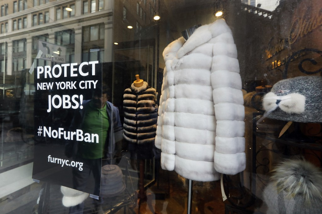 This April 10, 2019, photo shows a sign by furnyc.org in the window of Victoria Stass Collection in New York's fur district. The fur trade is consider