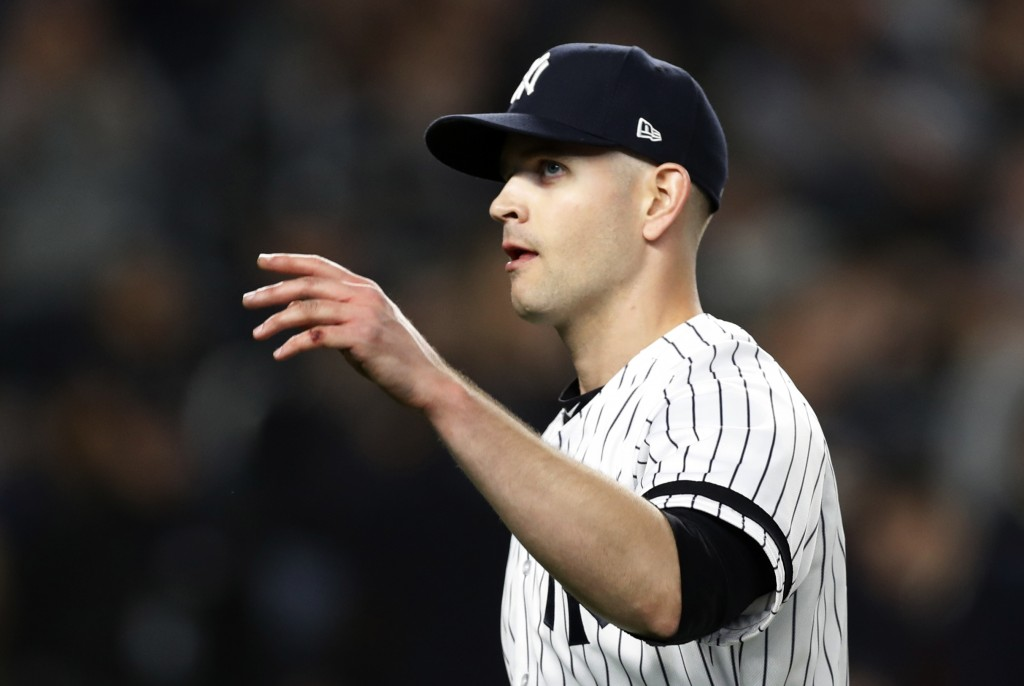 New York Yankees starting pitcher James Paxton waves to the crowd after pitching eight innings in the Yankees' 8-0 win over the Boston Red Sox in a ba