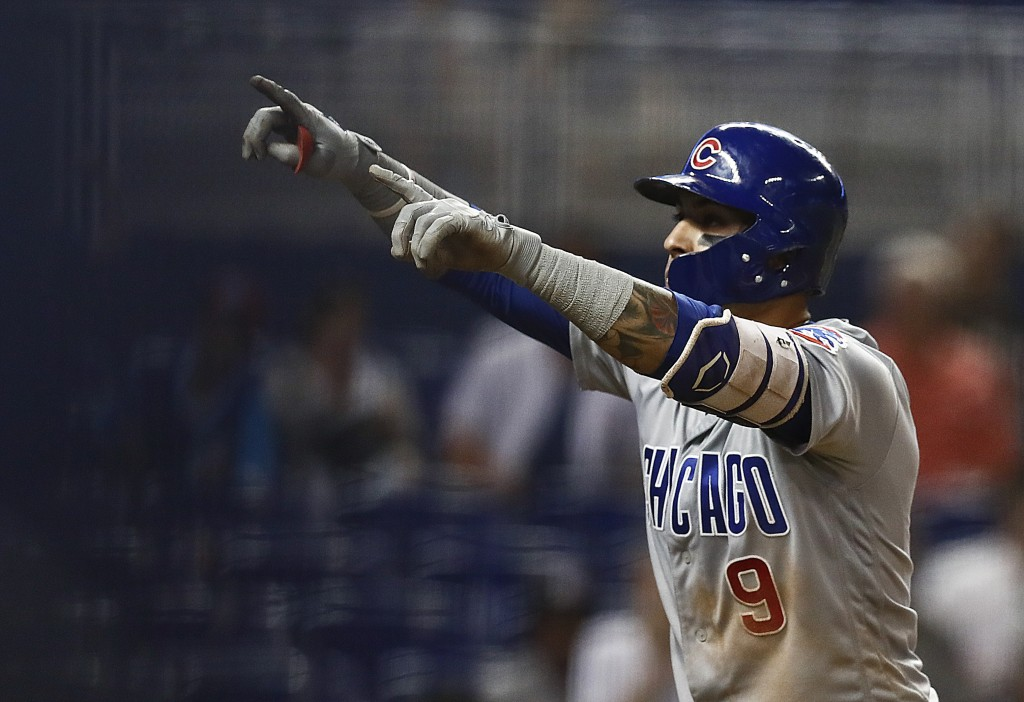 Chicago Cubs' Javier Baez (9) celebrates after hitting a solo home run off Miami Marlins pitcher Adam Conley during the eighth inning of a baseball ga