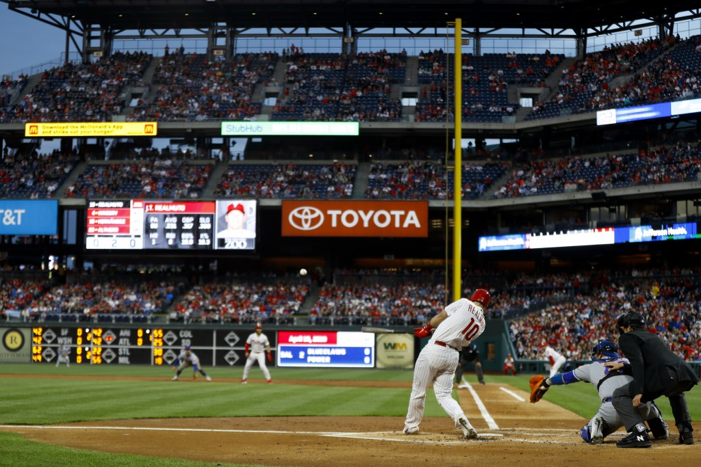Philadelphia Phillies' J.T. Realmuto hits a two-run double off New York Mets starting pitcher Steven Matz during the first inning of a baseball game,
