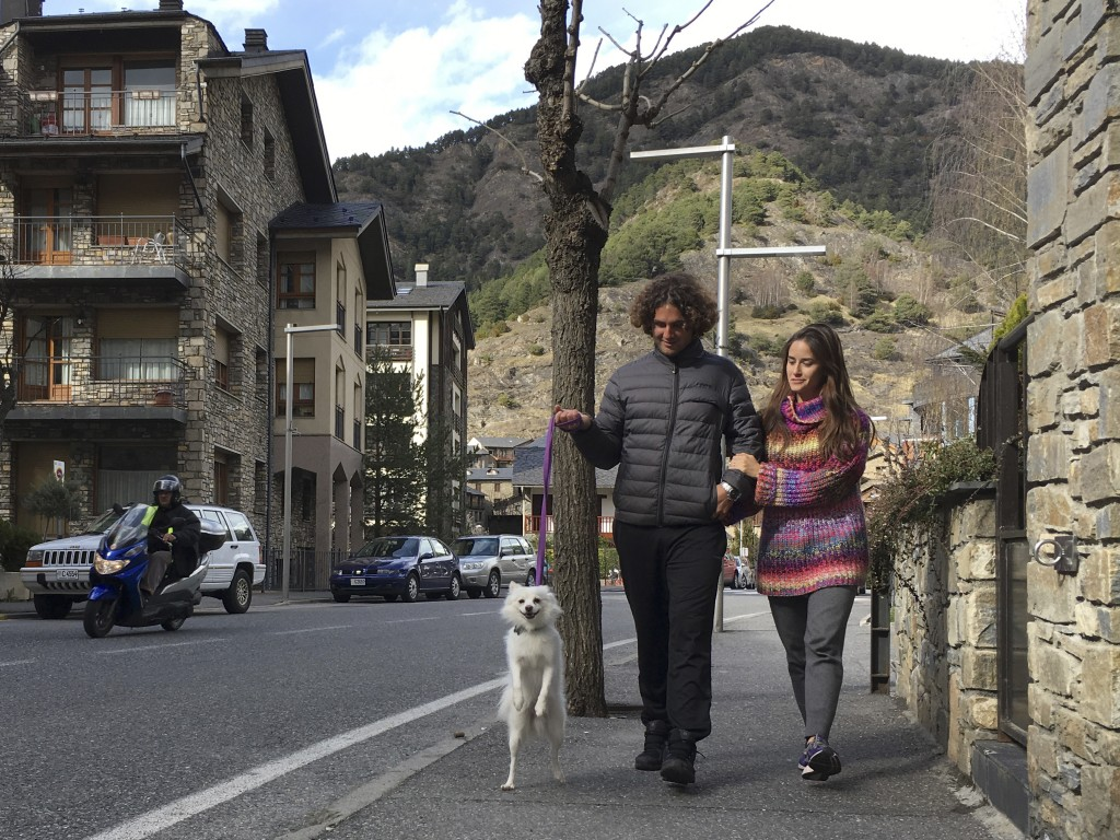 Marco Trungelliti and his wife, Nadir, walk their dog in the principality of Andorra Monday, April 8, 2019. Blowing the whistle on betting-related cor